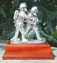 """The Branch"" Pair of Firefighters - Silver on a Mahogany Base"